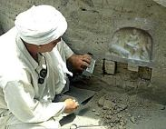 Excavating a sandstone Stele or wall carving from the wall of an ancient temple