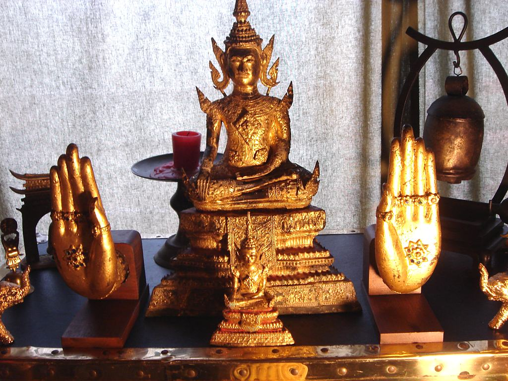 Douglas Wayne's home Buddha Shrine including gilded hands from a large temple statue