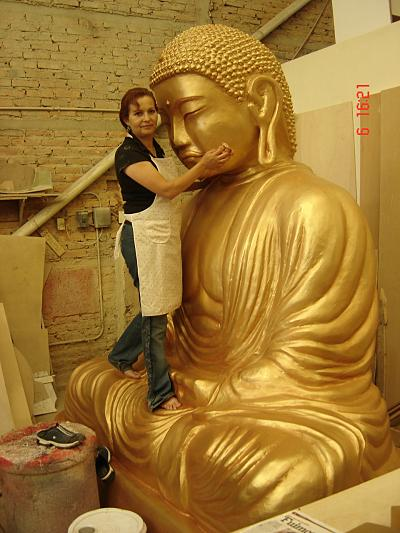 Fiberglass buddha created by Lucy Topete of Mexico